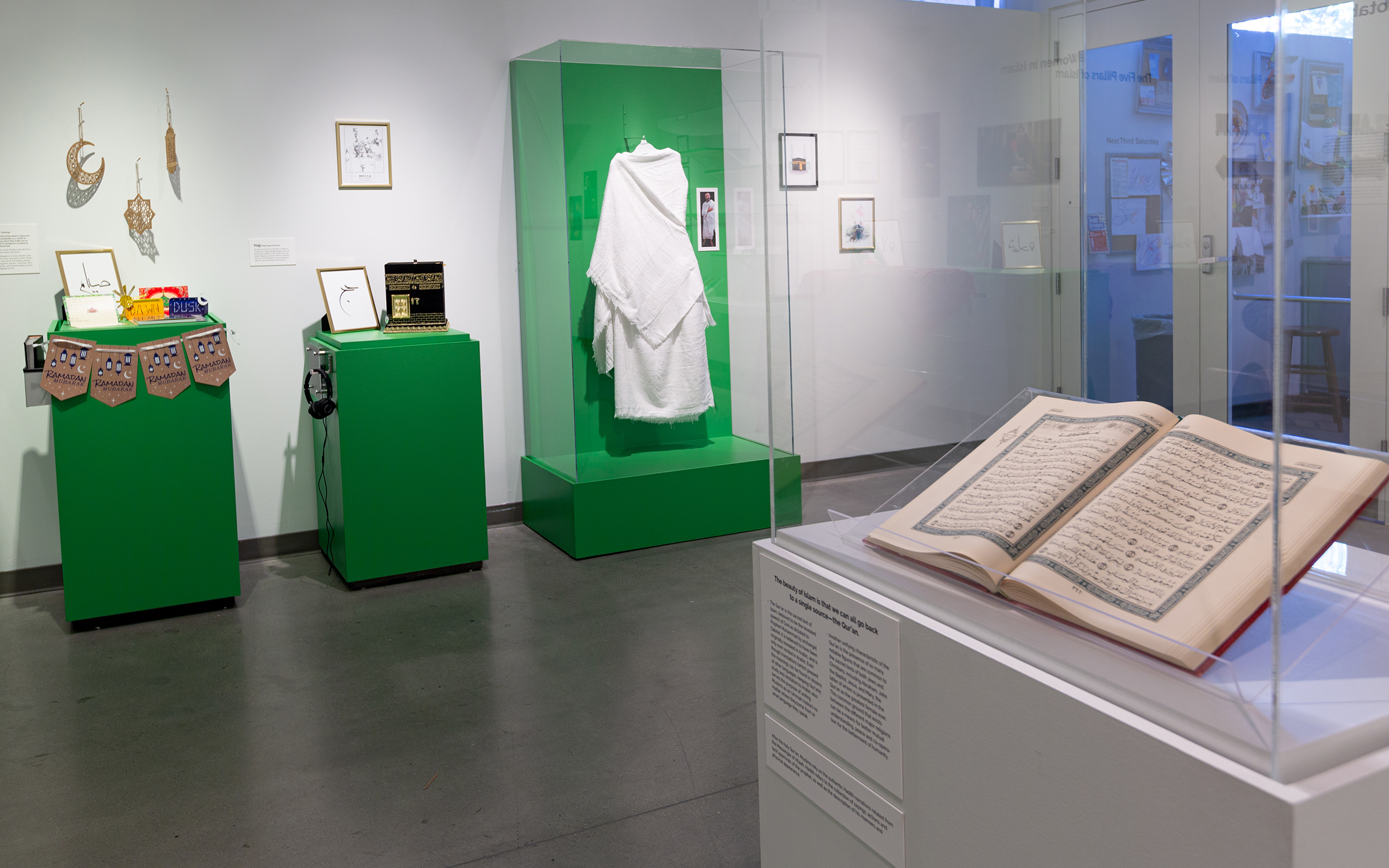 Ummah exhibition featuring the Quran and the foive pillars of Islam