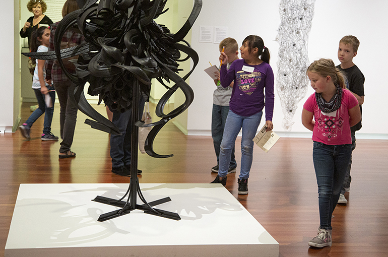 Children in Modern Contemporary gallery look at Chakaia Booker Discarded Memories