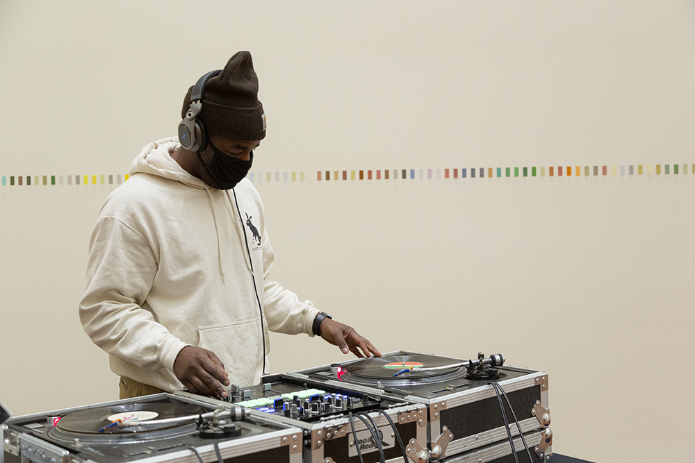 Amir Jackson playing a DJ set in the UMFA Great Hall