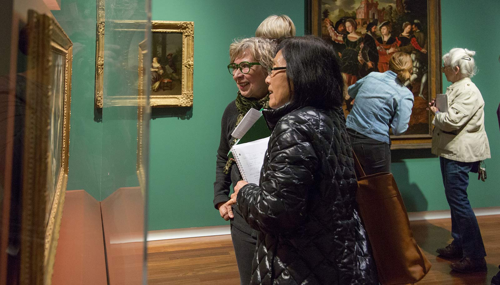 Docents looking at a work of art