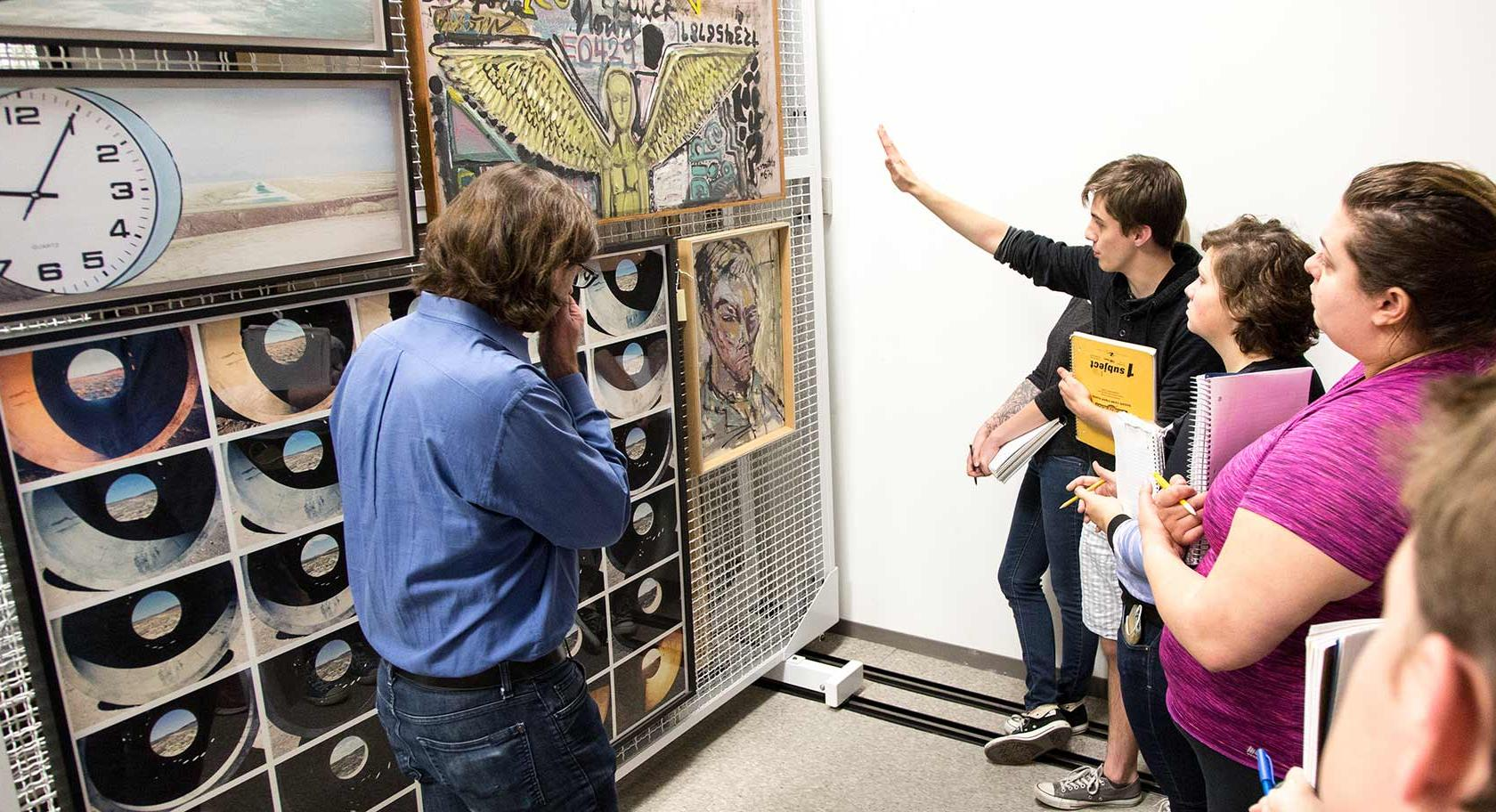 U of U Art History Professor Monty Perret and students discusses Robert Smithon's paintings in the UMFA's collections storage.