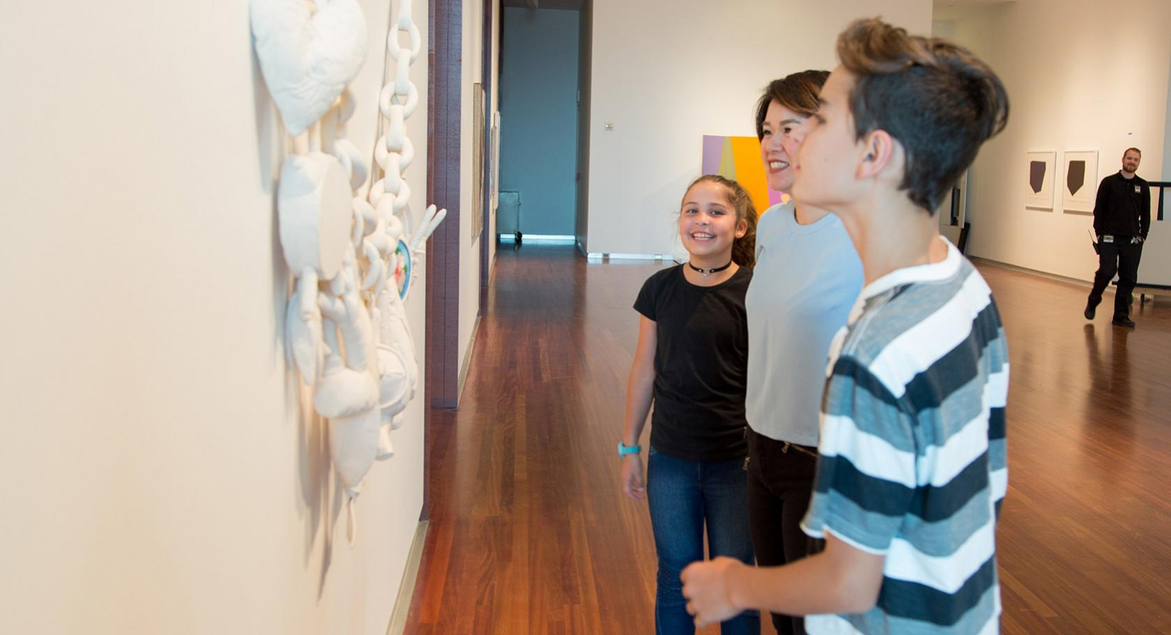 Students close looking in modern & contemporary gallery