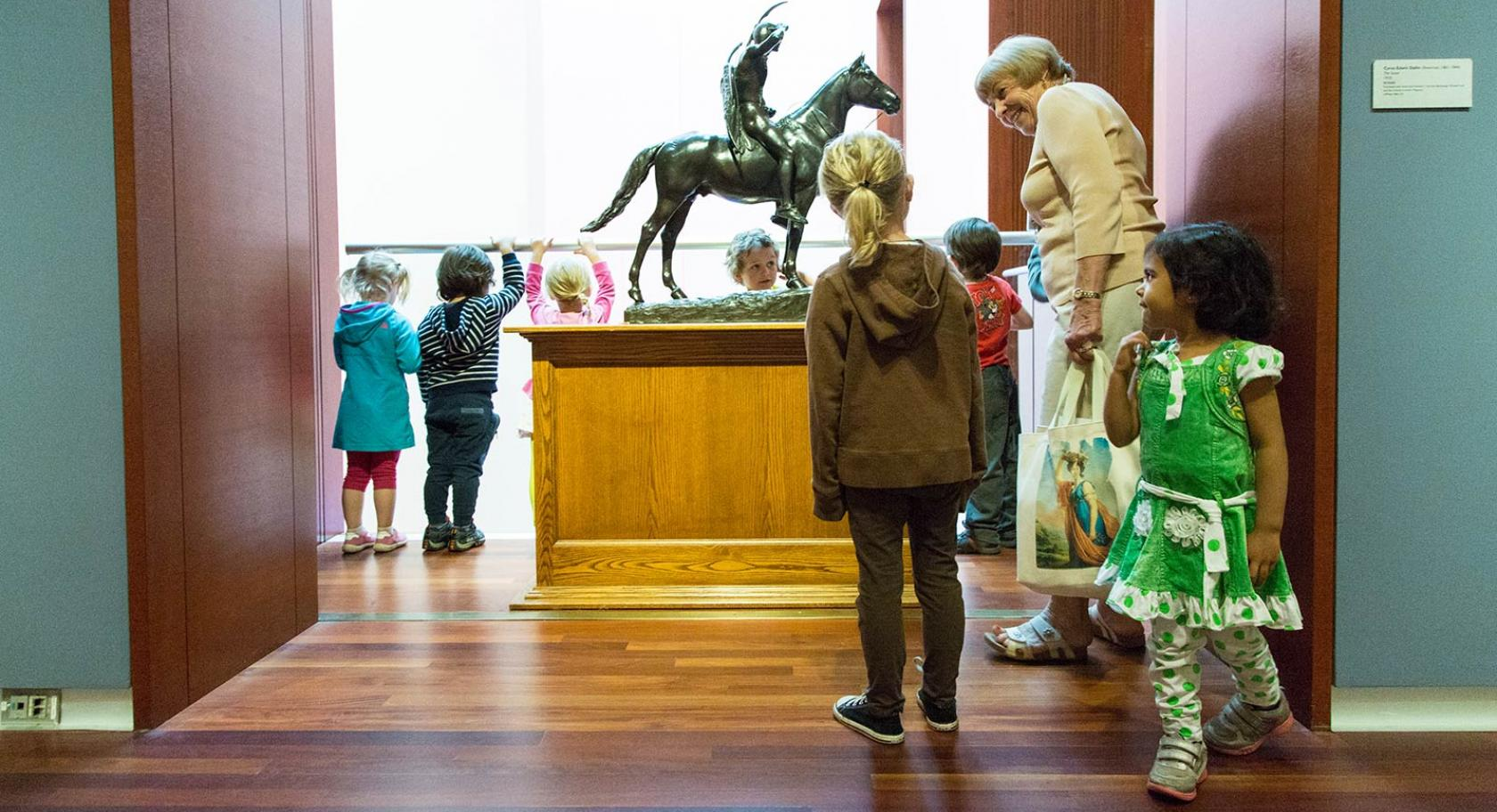 A UMFA docent educates young students about the collection.