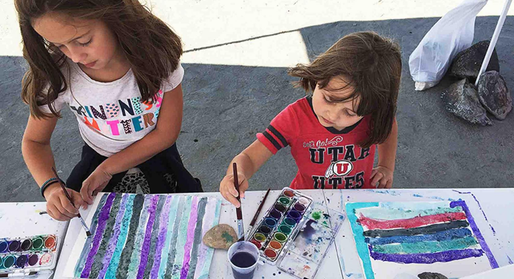 Kids water color painting at the UMFA Spiral Jetty meet up.