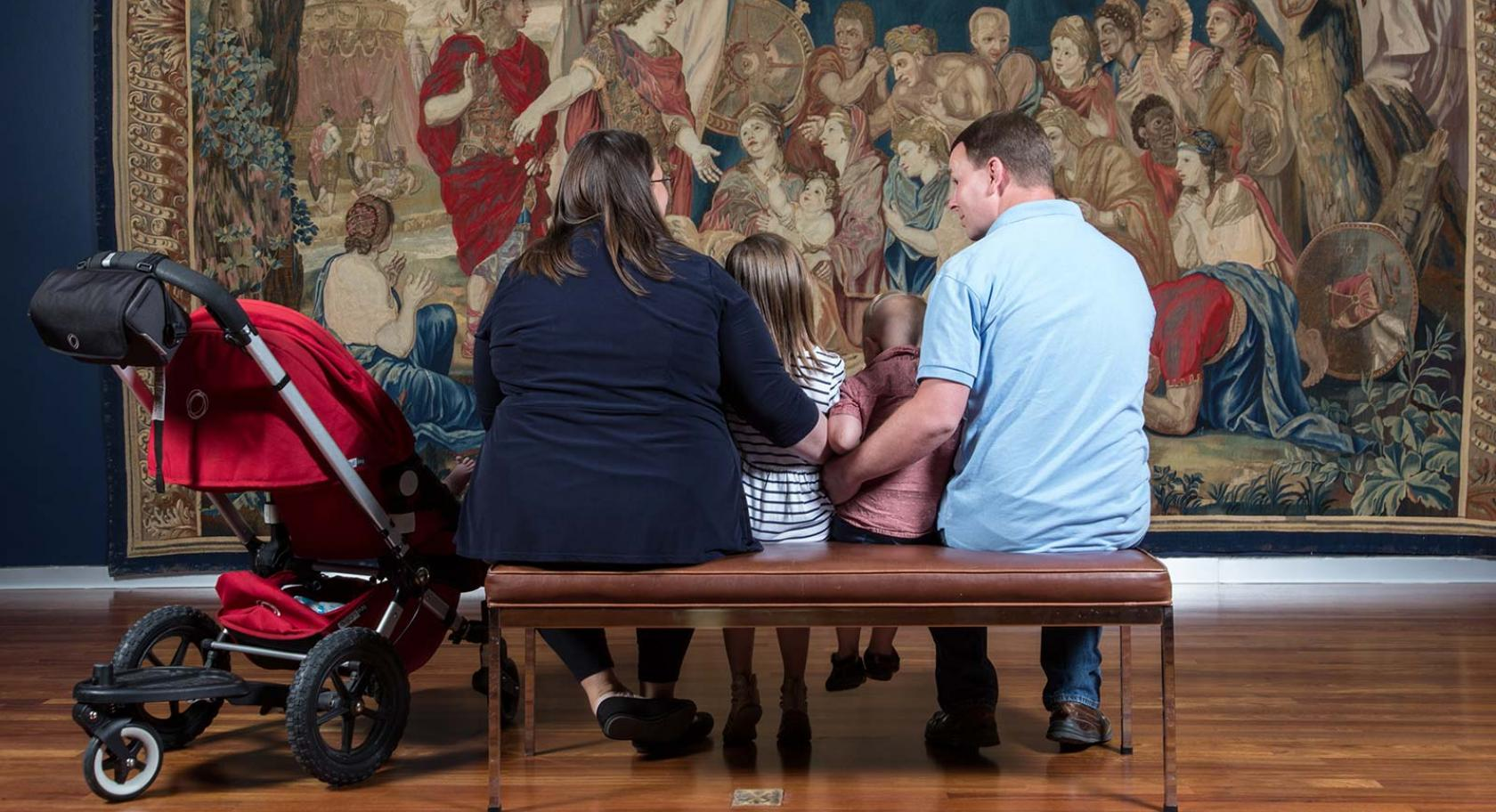 Family viewing a work of art together.