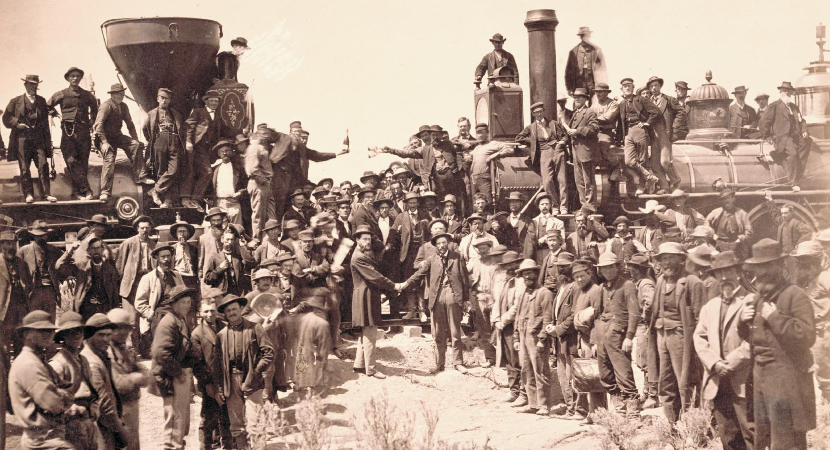 Andrew J. Russell (American, 1830­1902), East and West Shaking Hands at Laying Last Rail, 1869, albumen print, courtesy Union Pacific Railroad Museum. The ceremony spotlighted Union Pacific locomotive No. 119 meeting Central Pacific locomotive Jupiter. From left, shaking hands, are Samuel S. Montague, chief engineer of the Central Pacific Railroad, and General Grenville M. Dodge, chief engineer of the Union Pacific Railroad.