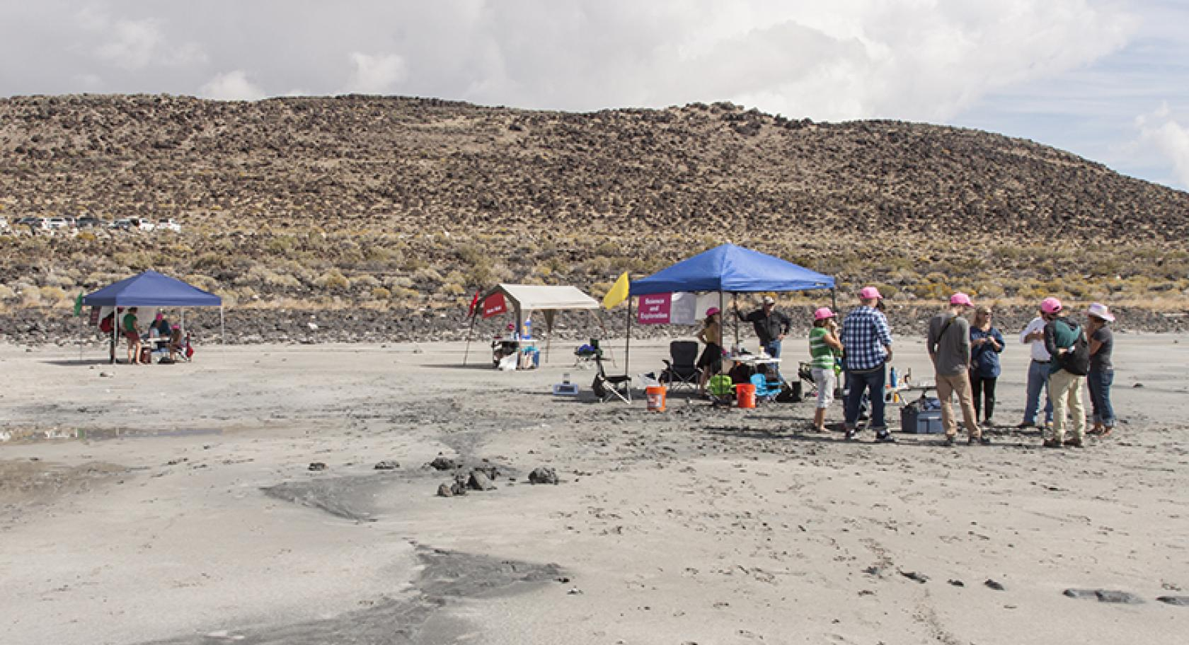 families gather at the Spiral Jetty at a Utah museum of Fine Arts meetup in 2015