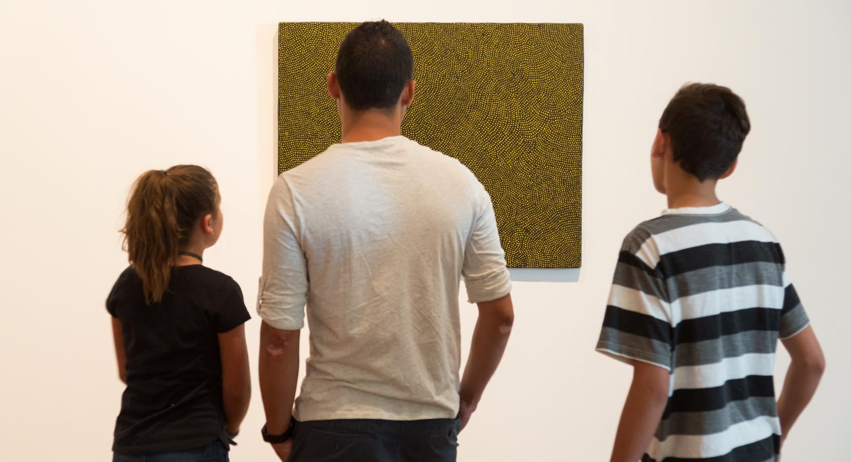 Families examining modern and contemporary art at the UMFA