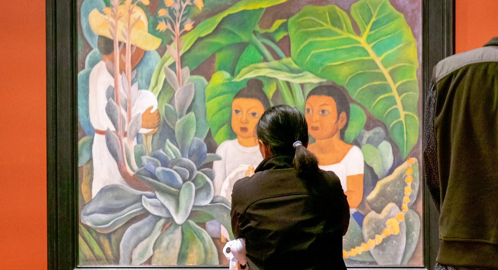 Woman gazing at Diego Rivera's La ofrenda (1931)