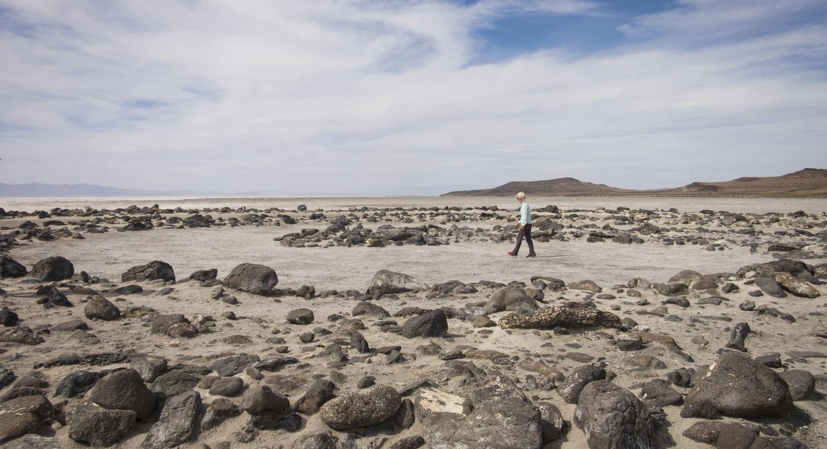 Visitor walks along Spiral Jetty at Rozel Point of Great Salt Lake