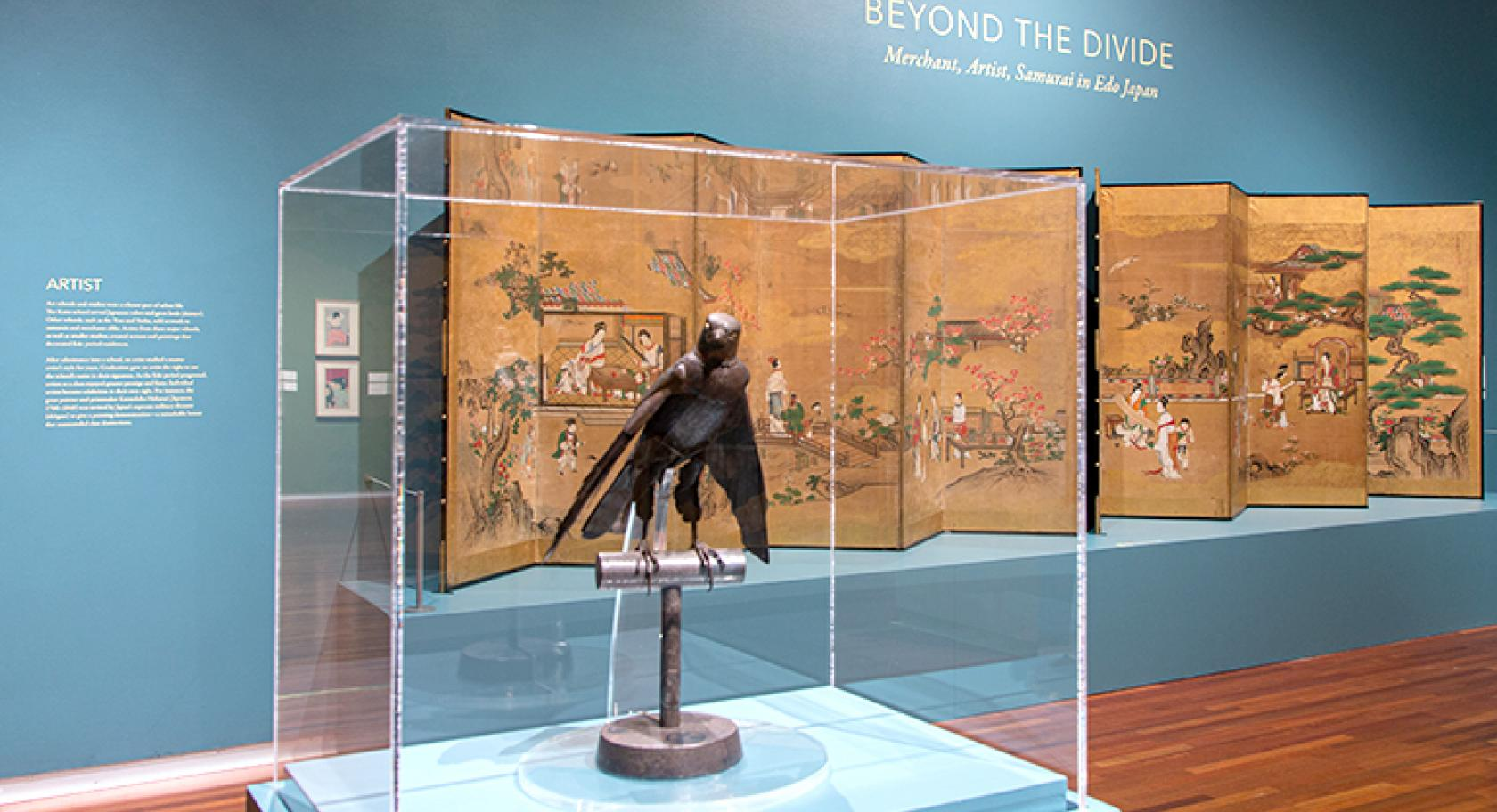 Beyond the Divide gallery, Articulated Raptor in front of Four Scholarly Arts screen