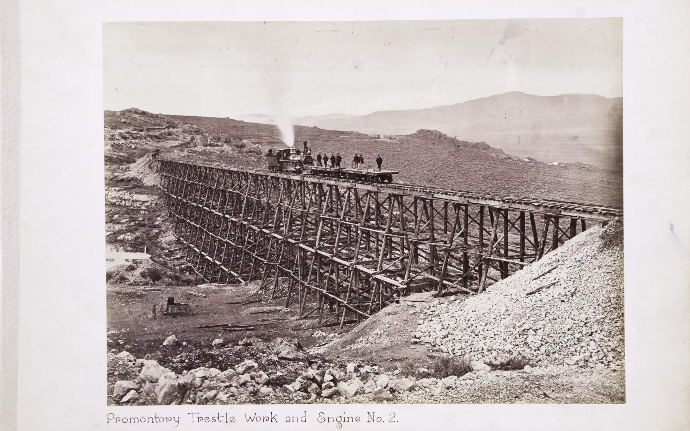 Andrew J. Russell, (American, 1829–1902), Promontory Trestle Work and Engine No. 2, 1869, albumen silver print, courtesy Union Pacific Railroad Museum