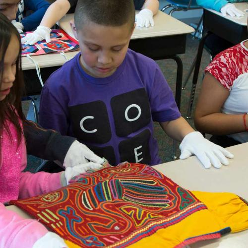 Students learning about art in their classroom through the UMFA's pARTners program.
