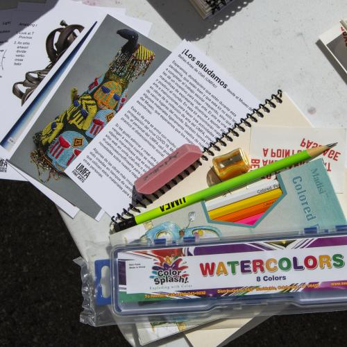 The kits included watercolor sets, colored pencils, UMFA pencils, erasers, sharpeners, and art activity prompts.