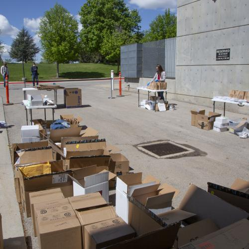 Boxes of art materials during assembly at the UMFA loading dock
